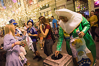 MOSCOW, RUSSIA - June 26, 2018: Some Japanese fans share a laugh with some Russians while a Brazil fan smokes a cigarette on Nikolskaya Street during the 2018 FIFA World Cup. The street was a crossroads for foreign soccer fans during the World Cup in Russia.