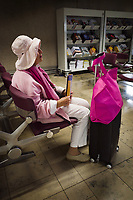 Switzerland. Canton Ticino. Zurich Airport An elderly fashionable woman dressed with pink clothes and hat seats in the waiting area. Zurich Airport (German: Flughafen Zürich, IATA: ZRH, ICAO: LSZH), also known as Kloten Airport, is the largest international airport of Switzerland. 29.05.2019  © 2019 Didier Ruef