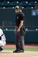 Home plate umpire Hector Cuellar works the game between the Hickory Crawdads and the Winston-Salem Dash at Truist Stadium on July 10, 2021 in Winston-Salem, North Carolina. (Brian Westerholt/Four Seam Images)