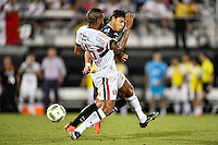 Orlando, FL - Saturday Jan. 21, 2017: São Paulo defender Junior (16) tackles the ball from Corinthians foward Romero (11) during the second half of the Florida Cup Championship match between São Paulo and Corinthians at Bright House Networks Stadium. The game ended 0-0 in regulation with São Paulo defeating Corinthians 4-3 on penalty kicks.
