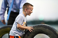 Batavia Muckdogs young fan participate in the dizzy bat tire race on field promotion during a game against the State College Spikes on June 24, 2016 at Dwyer Stadium in Batavia, New York.  State College defeated Batavia 10-3.  (Mike Janes/Four Seam Images)
