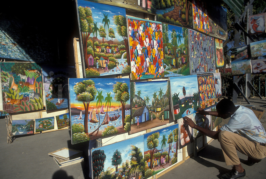 AJ2282, Haiti, Caribbean, Haitian street artist displays his naive paintings on the street in the city of Port-Au-Prince capital of Haiti.