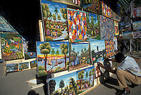 AJ2282, Haiti, Caribbean, Haitian street artist displays his naive paintings on the street in the city of Port-Au-Prince capital of Haiti.
