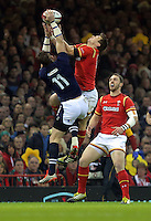 (L-R) Sean Lamont of Scotland clashes mid-air against Dan Biggar of Wales during the RBS 6 Nations Championship rugby game between Wales and Scotland at the Principality Stadium, Cardiff, Wales, UK Saturday 13 February 2016