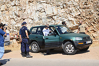 Pictured: Pathologist Nikos Karakoukis (C) arrives at the scene in Ikaria, Greece. Thursday 08 August 2019<br /> Re: Rescuers searching for  British scientist Natalie Christopher, 35, who disappeared on the  island of Ikaria, Greece have found her body at the bottom of a ravine.<br /> She was found less than a mile from the hotel in the Kerame area where she was on holiday with her Cypriot partner.<br /> Emergency service staff said that a large rock had dislodged as she fell, causing multiple head injuries.<br /> The woman's body will be kept overnight at the spot so a coroner can examine it on Thursday morning.
