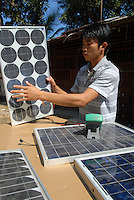 Laos, Vientiane, lao german company Sunlabob install solar panels and renewable energy equipment in remoted villages, solar workshop, vocational training / Laos, Vientiane, deutsche laotische Firma Sunlabob installiert Solaranlagen zur autarken Energieversorgung in abgelegenen Doerfern, Solar Werkstatt und berufliche Bildung