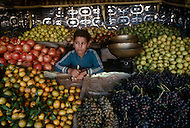 Young boy manages a fruit stand in Fez, Morocco - Child labor as seen around the world between 1979 and 1980 - Photographer Jean Pierre Laffont, touched by the suffering of child workers, chronicled their plight in 12 countries over the course of one year.  Laffont was awarded The World Press Award and Madeline Ross Award among many others for his work.