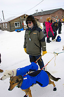 Race Judge Al Marple holds Jason Barron's lead dogs during Jason's brief stop to check in at Shageluk