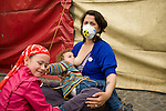 A young mother breastfeeds her child at an Anti Nuclear Rally held on the Dam Square in Amterdam, the Netherlands on April 16, 2011. Thousands of people gathered on the square to protest recent Netherlands government movements to increase nuclear power in the country.