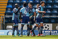 Adebayo Akinfenwa of Wycombe Wanderers (left) celebrates scoring the opening goal during the The Checkatrade Trophy match between Wycombe Wanderers and West Ham United U21 at Adams Park, High Wycombe, England on 4 October 2016. Photo by David Horn.