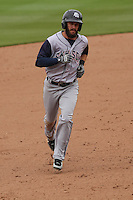 Colorado Springs Sky Sox outfielder Matt Long (12) rounds the bases following a home run during a Pacific Coast League game against the Iowa Cubs on May 11th, 2015 at Principal Park in Des Moines, Iowa.  Colorado Springs defeated Iowa 13-7.  (Brad Krause/Four Seam Images)