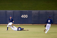 AZL Brewers center fielder Jesus Lujano (26) makes a diving catch as left fielder Robert Henry (49) and second baseman Jean Carmona (5) look on against the AZL Cubs on August 24, 2017 at Maryvale Baseball Park in Phoenix, Arizona. AZL Cubs defeated the AZL Brewers 9-1. (Zachary Lucy/Four Seam Images)