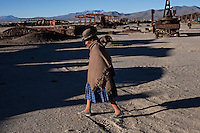 """Uyuni, Bolivia.March 31, 2013.A local lady walks in the train cemetery in the city of Uyuni, Uyuni will host the Dakar 2014 in Bolivia next January.  ©PATRICIO CROOKER/ARCHIVO LATINO For  the first time in its history,  in January 2014 the Dakar Rally will  be cross part of Bolivia, one of the wildest South American nations.  """"The organizers of the Dakar, attracted by the discovery of new spaces, were conquered by Bolivian landscapes that can be classified among the most striking of the continent,"""" says the official site of the international race.<br /> The most impressive is the section that runs through the Salar of Uyuni,  considered the world's largest salt flat and a place of surreal beauty, almost otherworldly.<br /> The competition is scheduled for  in January 2014. Our photographer and  friend Patricio Crooker  show us  the unique beauty of the places the rally will hit."""