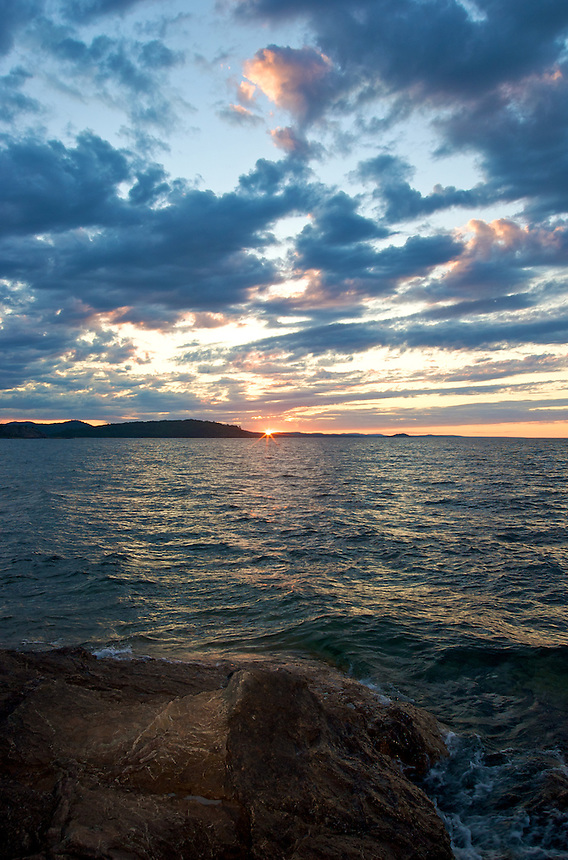 A summer sunset looking over Lake Superior at Presque Isle Park. Marquette, MI