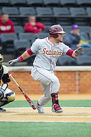 DJ Stewart (8) of the Florida State Seminoles follows through on his swing against the Wake Forest Demon Deacons at Wake Forest Baseball Park on April 19, 2014 in Winston-Salem, North Carolina.  The Seminoles defeated the Demon Deacons 4-3 in 13 innings.  (Brian Westerholt/Four Seam Images)