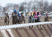 Racing toward the wire in the Tom Fool it was anyone's race. It came down to Comma to the Top, in the pink on the rail, and Saturday's Charm, in the blue second from left.