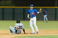 AZL Cubs 2 second baseman Reivaj Garcia (24) shows the ball to the field umpire after tagging Cristopher Cespedes (30) on a stolen base attempt during an Arizona League game against the AZL Indians 2 at Sloan Park on August 2, 2018 in Mesa, Arizona. The AZL Indians 2 defeated the AZL Cubs 2 by a score of 9-8. (Zachary Lucy/Four Seam Images)