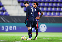 WIENER NEUSTADT, AUSTRIA - NOVEMBER 16: Giovanni Reyna #7 and Weston McKennie #8 of the United States stan d over the ball during a game between Panama and USMNT at Stadion Wiener Neustadt on November 16, 2020 in Wiener Neustadt, Austria.
