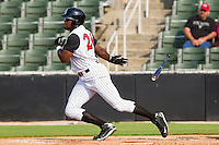 Kenny Gilbert #26 of the Kannapolis Intimidators follows through on his swing against the Greenville Drive at Fieldcrest Cannon Stadium on May 8, 2011 in Kannapolis, North Carolina.   Photo by Brian Westerholt / Four Seam Images