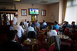 Marine 3 Ilkeston FC 1, 19/09/2015. The Mersey Travel Arena, Northern Premier League. Supporters watching a Premier League match on television in the social club next to the Mersey Travel Arena, home to Marine Football Club, before they played host to Ilkeston FC in a Northern Premier League premier division match. The match was won by the home side by 3 goals to 1 and was watched by a crowd of 398. Marine are baed in Crosby, Merseyside and have played at Rossett Park (now the Mersey Travel Arena)  since 1903, the club having been formed in 1894.  Photo by Colin McPherson.