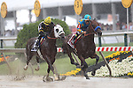 May 16, 2015:  American Pharoah, with Victor Espinoza, and Mr.Z,  ridden by Corey Nakatani, are in the lead as the field passes the stands for the first tim.   American Pharoah, Victor Espinoza up,  wins the Preakness Stakes at Pimlico Race Course in Baltimore, MD. Trainer is Bob Baffert; owner is Ahmed Zayat. Joan Fairman Kanes/ESW/CSM