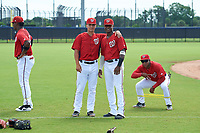 GCL Nationals Allan Berrios (left), Junior Martina (right), and Jaylen Hubbard (kneeling) before a Gulf Coast League game against the GCL Astros on August 9, 2019 at FITTEAM Ballpark of the Palm Beaches training complex in Palm Beach, Florida.  GCL Nationals defeated the GCL Astros 8-2.  (Mike Janes/Four Seam Images)