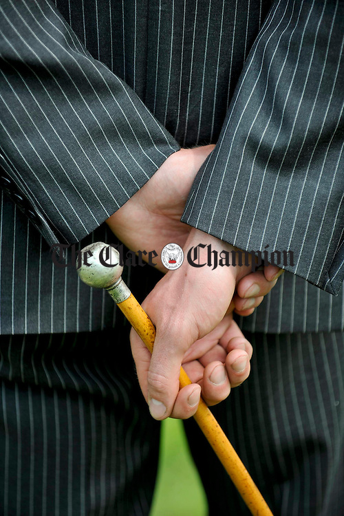 Particular in Pinstripes................ A well dressed stock judge holds his cane at Ennistymon Show. Photograph by John Kelly.