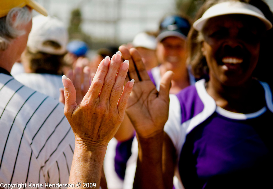 The Golden Girls, left, congratulate the Kentucky Fillies, right, at the end of the game. During the Senior Games 2009, at Twin Creeks Sports Complex, in Sunnyvale, Calif., on Monday, August 10, 2009.