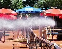 05-08-13, Netherlands, Dordrecht,  TV Desh, Tennis, NJK, National Junior Tennis Championships, Watering the court<br /> <br /> <br /> Photo: Henk Koster