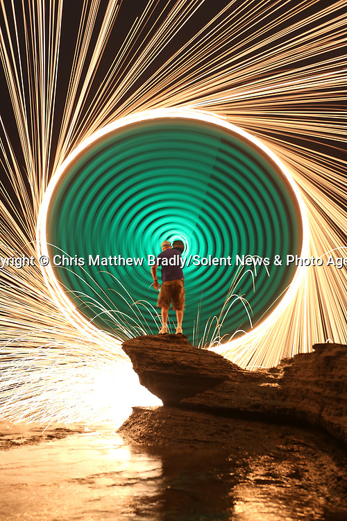 A spinning disc creates an extraordinary umbrella of sparks which illuminate the night sky.  This incredible effect is the result of lighting steel wire wool attached to a nylon 'trick line' and spinning it in circles.<br /> <br /> The long exposure shots were taken over three second periods at Sunset Cliffs National Park, in San Diego, USA, by hotel worker Chris Brady, who has been practising steel wool photography for over five years.  SEE OUR COPY FOR DETAILS.<br /> <br /> Please byline: Chris Matthew Bradly/Solent News<br /> <br /> © Chris Matthew Bradly/Solent News & Photo Agency<br /> UK +44 (0) 2380 458800