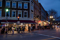 Intersection on Harvard Square with student bookshops and restaurants in Cambridge. MA