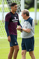 England manager Roy Hodgson and Chris Smalling during training