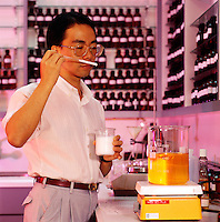 Parfumier working in fragrance lab, Hong Kong.