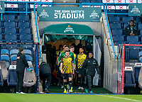 19th December 2020 The John Smiths Stadium, Huddersfield, Yorkshire, England; English Football League Championship Football, Huddersfield Town versus Watford; Tom Cleverley of Watford leads the teams out