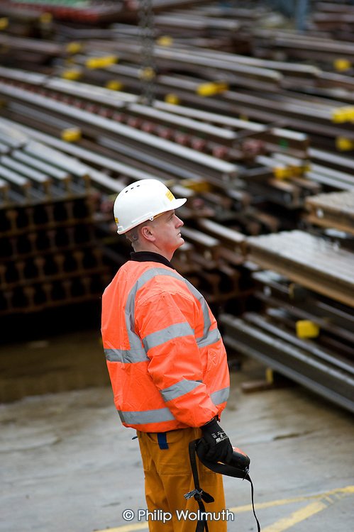 A worker in the Points and Crossings Shed of London Underground's  Lillie Road Depot.  The depot produces replacement track for the tube network and offers a same day service for 'urgencies and emergencies'.  The depot is now run by London Underground following the collapse of PPP contractor Metronet in 2007.