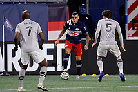 20th November 2020; Foxborough, MA, USA;  New England Revolution forward Gustavo Bou takes on Montreal Impact midfielder Rod Fanni and defender Luis Binks during the MLS Cup Play-In game between the New England Revolution and the Montreal Impact