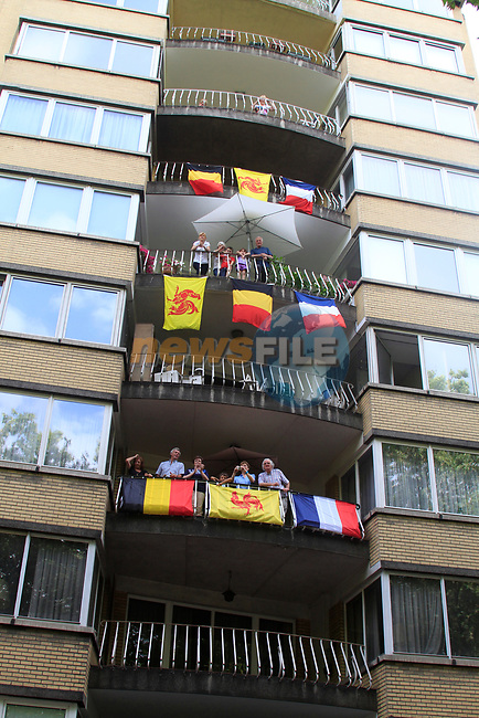 Apartment block decked out in flags during the Prologue of the 99th edition of the Tour de France 2012, a 6.4km individual time trial starting in Parc d'Avroy, Liege, Belgium. 30th June 2012.<br /> (Photo by Eoin Clarke/NEWSFILE)
