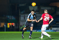 Luke O'Nien of Wycombe Wanderers heads forward during the Sky Bet League 2 match between Wycombe Wanderers and Crawley Town at Adams Park, High Wycombe, England on 28 December 2015. Photo by Andy Rowland / PRiME Media Images