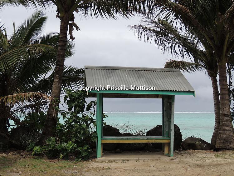 Rarotonga, Cook Islands - September 21, 2012:  A bus stop on the main road, Ara Tapu, has a view of the lagoon.