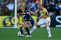 MELBOURNE, AUSTRALIA - DECEMBER 27: Billy Celeski of the Victory and Jobe Wheelhouse of the Jets contest the ball during the round 20 A-League match between the Melbourne Victory and the Newcastle Jets at AAMI Park on December 27, 2010 in Melbourne, Australia. (Photo by Sydney Low / Asterisk Images)