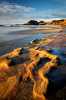 sandstone rock structure on shore of Seal Rock, Oregon