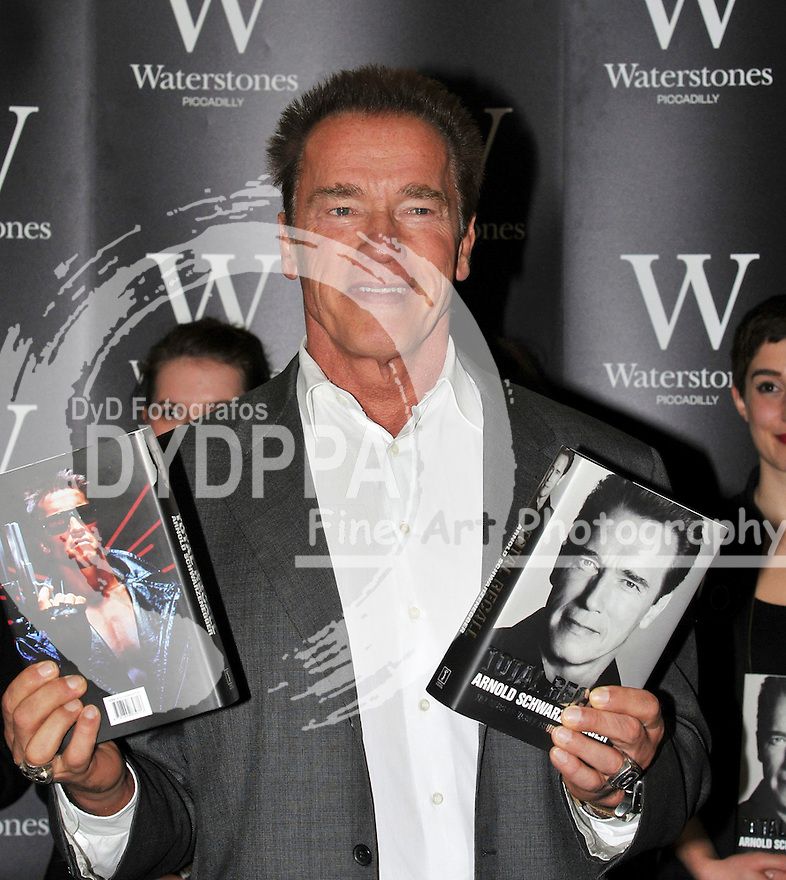 Arnold Schwarzenegger book signing.  Arnold Schwarzenegger, Hollywood actor turned Governor of California, in the UK to promote his eagerly awaited autobiography Total Recall: My Unbelievably True Life Story, signs copies.  Waterstone's, Piccadilly, London, United Kingdom, October 15, 2012. Photo by Nils Jorgensen / i-Images / DyD Fotografos