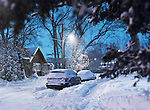 Cars on a snow covered city street after a storm. Wintertime scenery, Toronto, Ontario, Canada.