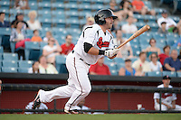 Nashville Sounds outfielder Caleb Gindl (13) at bat during the first game of a double header against the Omaha Storm Chasers on May 21, 2014 at Herschel Greer Stadium in Nashville, Tennessee.  Nashville defeated Omaha 5-4.  (Mike Janes/Four Seam Images)