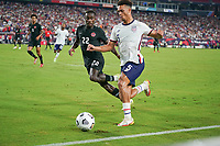 NASHVILLE, TN - SEPTEMBER 5: Antonee Robinson #5 of the United States races along the sideline during a game between Canada and USMNT at Nissan Stadium on September 5, 2021 in Nashville, Tennessee.