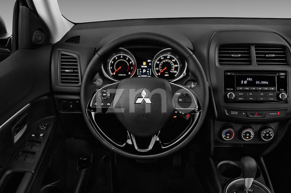 Car pictures of steering wheel view of a 2016 Mitsubishi Outlander-Sport 2.4-ES-AWC-CVT 5 Door SUV Steering Wheel