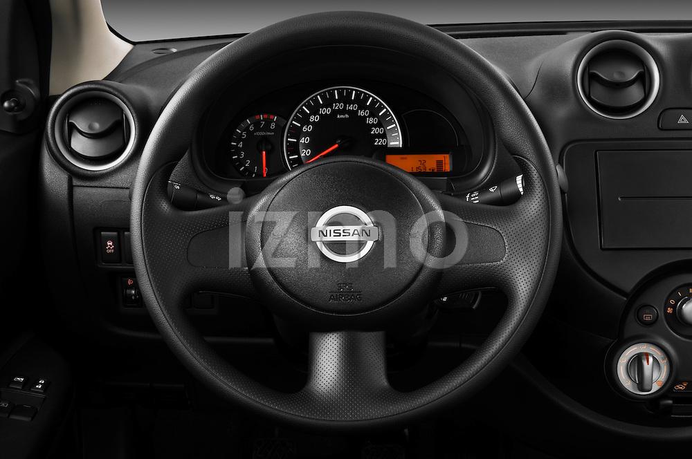 Steering wheel view of a 2011 Nissan Micra Visia 5 Door Micro Car