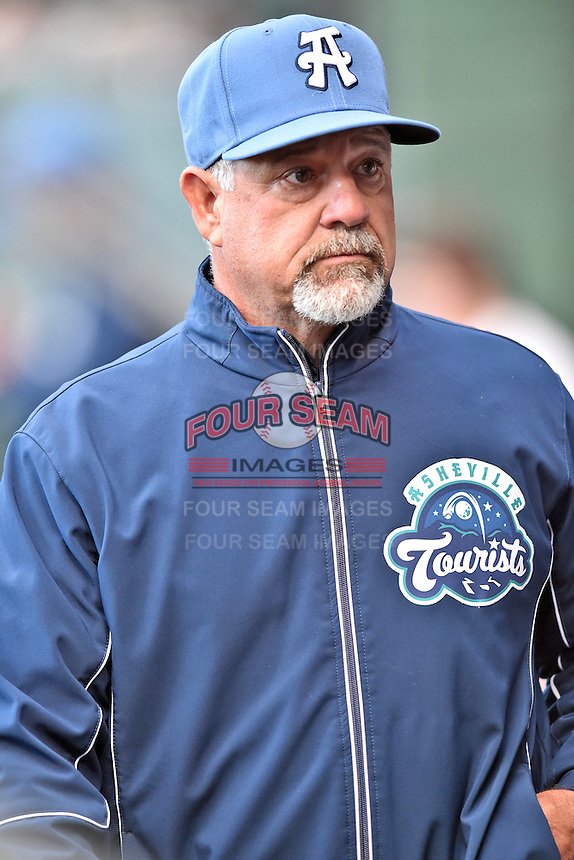 Asheville Tourists pitching coach Mark Brewer (8) during a game against the Greenville Drive at Fluor Field on April 7, 2016 in Greenville South Carolina. The Drive defeated the Tourists 4-3. (Tony Farlow/Four Seam Images)