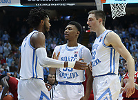 CHAPEL HILL, NC - FEBRUARY 25: Leaky Black #1, Christian Keeling #55, and Justin Pierce #32 of the University of North Carolina react after a UNC basket and a foul called on NC State during a game between NC State and North Carolina at Dean E. Smith Center on February 25, 2020 in Chapel Hill, North Carolina.