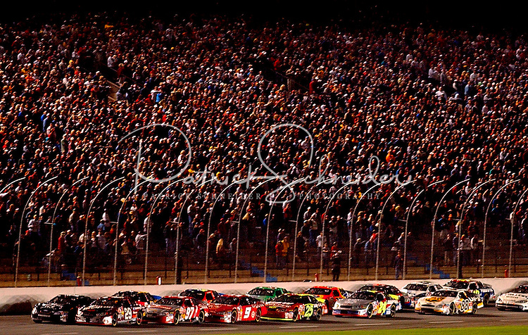 NASCAR driver Kevin Harvick (29) leads the field down the front stretch during a restart of the Winston at Lowe?s Motor Speedway.